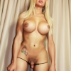 Busty blonde Tranny teases you with her massive tgirl cock